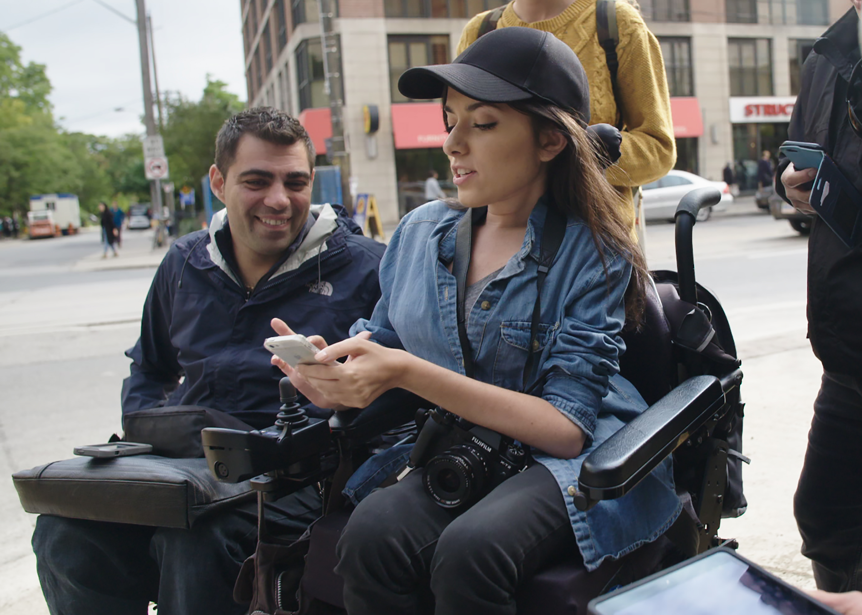 maayan shows off the app on toronto street