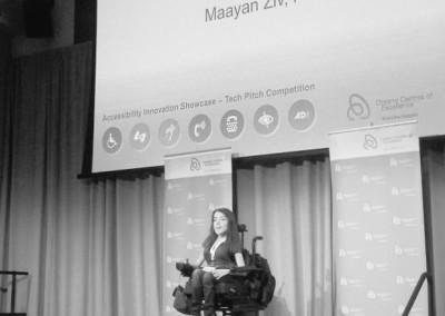 maayan presenting on stage OCE