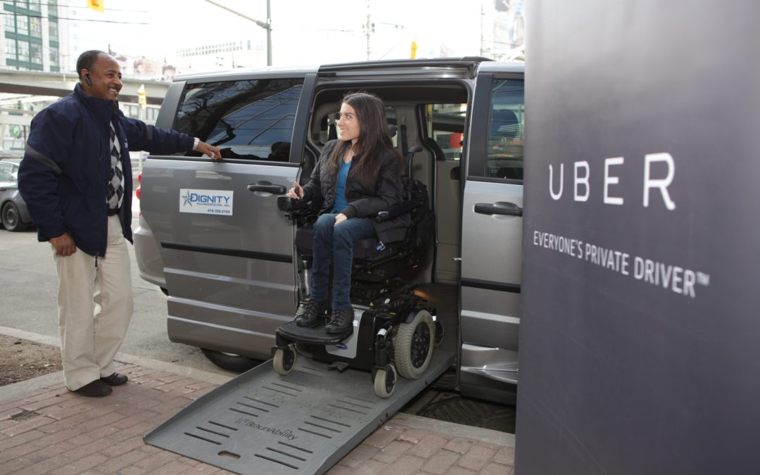 Maayan Ziv drives her power wheelchair out of an accessible taxi.