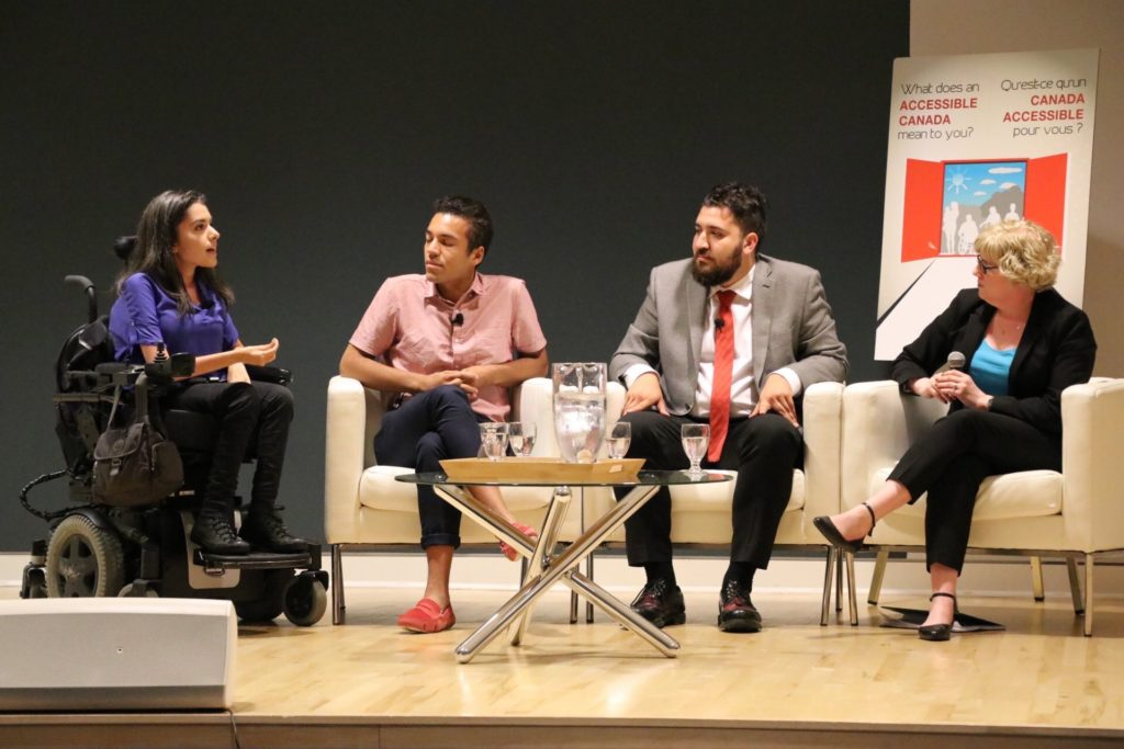 Youth panel discusses innovation with Carla Qualtrough. Maayan Ziv sits on left next to 2 others, followed by the Minister.