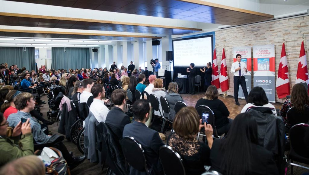 panorama of the national youth forum delegates as trudeau answers questions