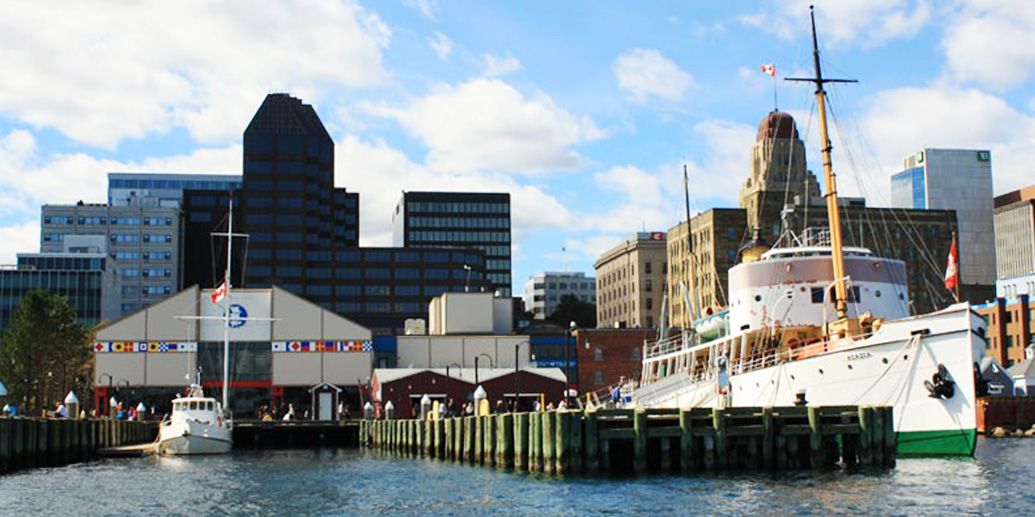 halifax harbour with dock and large sail boat