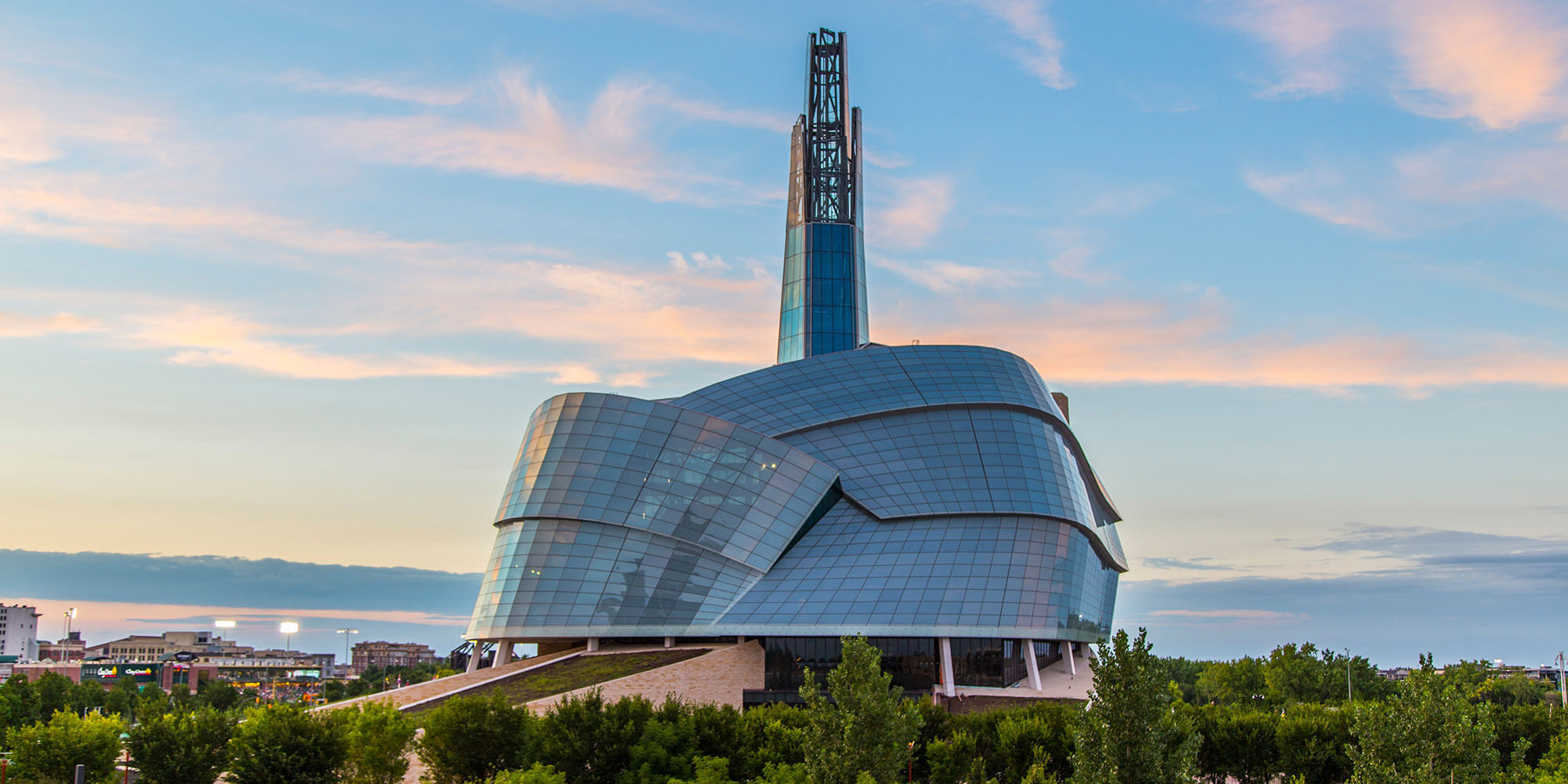 wide shot of Canadian Museum of Human Rights exterior at sunset.