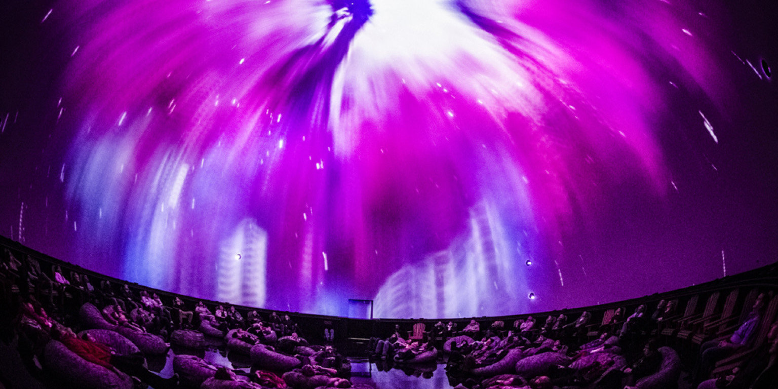 looking up at Planetarium dome with pink sky