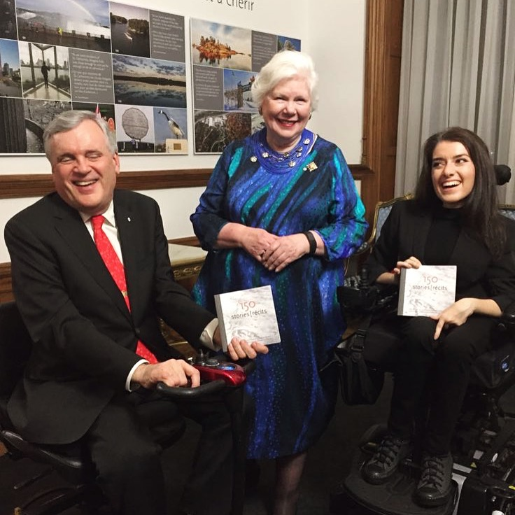 Maayan ziv, left, Jodi Kovitz, right, pose with a cheque for AccessNow.