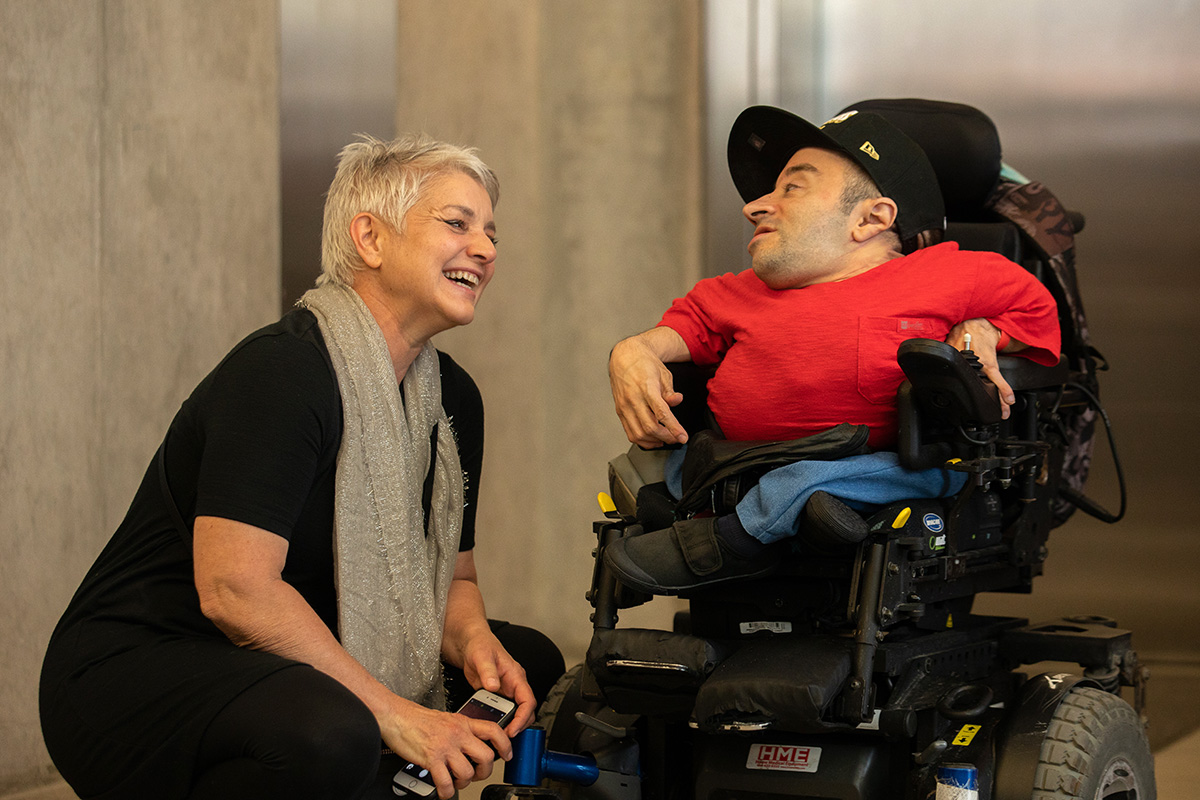 two inter-abled people laughing