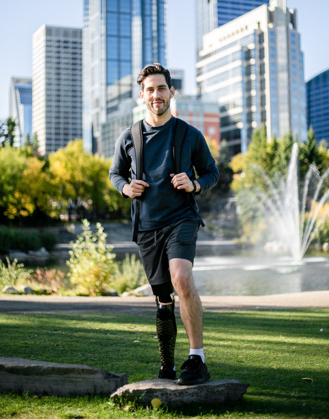 image of cody dolan smiling, he has a prosthetic leg